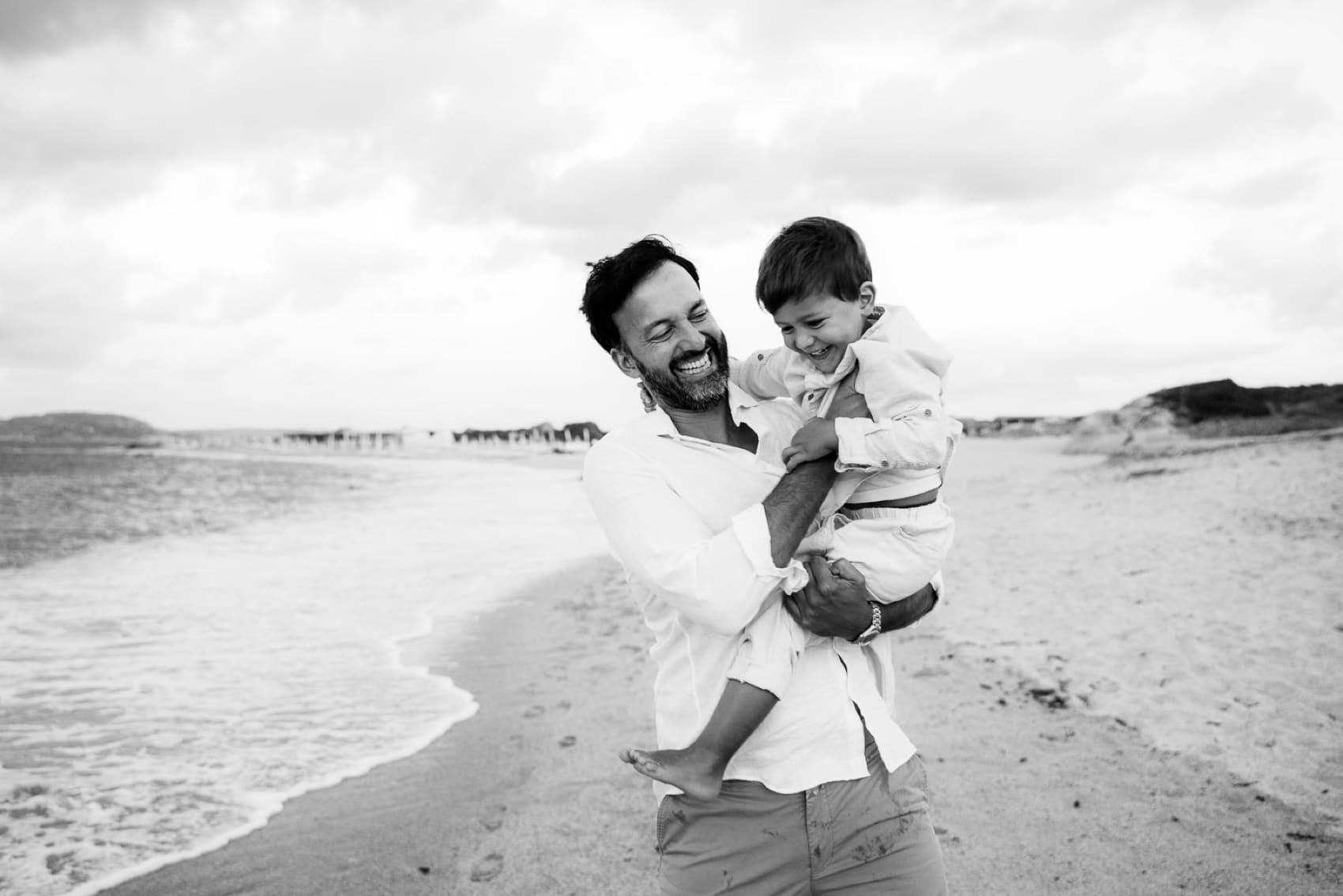 dad and son sardinia photo on the beach